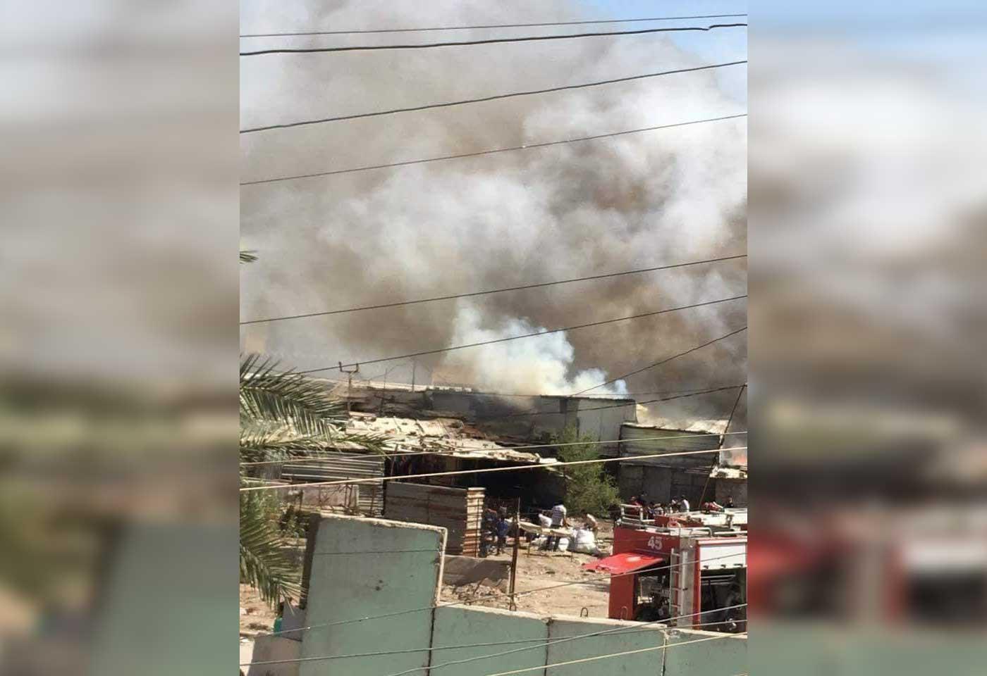 الدفاع المدني يخمد حريقاً اندلع بمحال تجارية جنوب شرقي بغداد